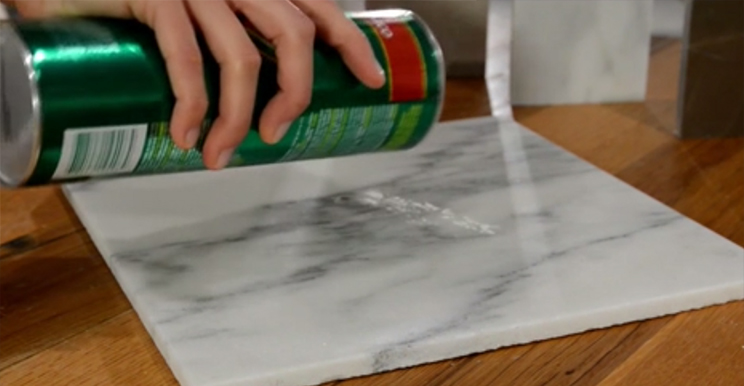 Reducing the Appearance of Acid Etching in Honed Marble